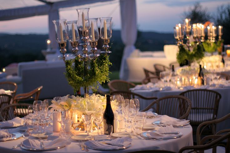 The table mise en place and decorations with silver candelabras