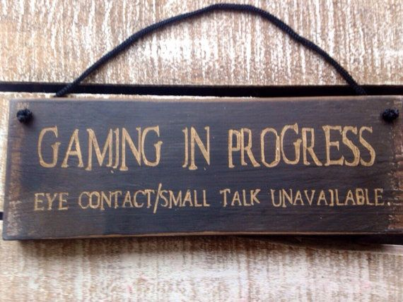 Gaming in Progress. Eye Contact/Small Talk Unavailable.    This sign is approx 27 x 9.5cm and handpainted onto recycled wood so each sign we create is completely unique. A blend of paints is used and then each one is sealed with a protective wax and comes ready to hang.  This sign is black & cream font.  Why not create a reversible sign to make your gift double the fun? This would work well with:- I went Outside Once But The Graphics Werent Great, which is also in the Teenagers secti...