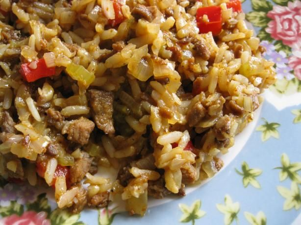 """Mimi's Dirty Rice - Mexican-type dirty rice. (Make """"dirt cheap"""" by omitting the sausage and adding a can of black beans. Could garnish with some cheese and salsa)"""