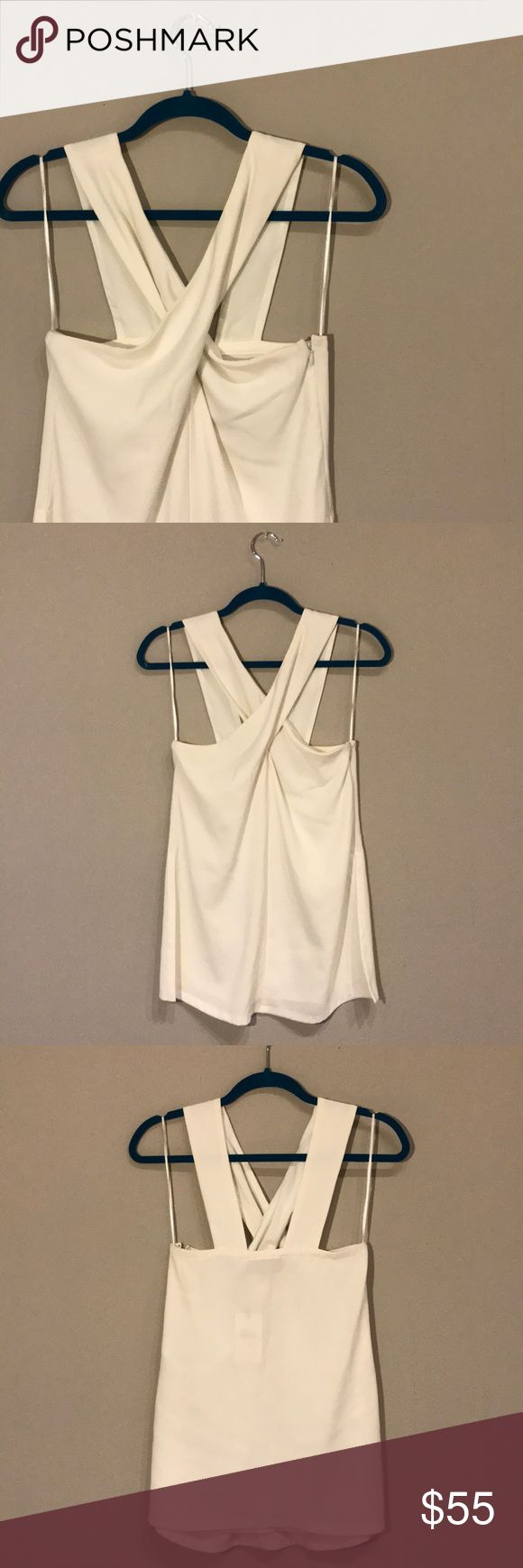 Cream Twist Top Brand New! Great for summer with a nice pair of skinny jeans and heels! Twisted at the front to give a sexy look. Side zipper for easy wear and high slits on the sides. 7 For All Mankind Tops