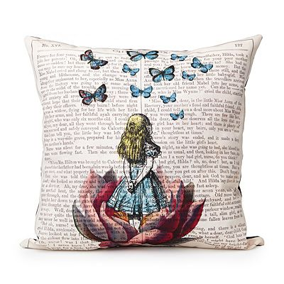 This sweet little throw pillow captures the essence of Alice's adventures and gives you just a touch of wonderland to bring back for yourself. This is a Great accent pillow for a reading chair. -VintageandKind.com