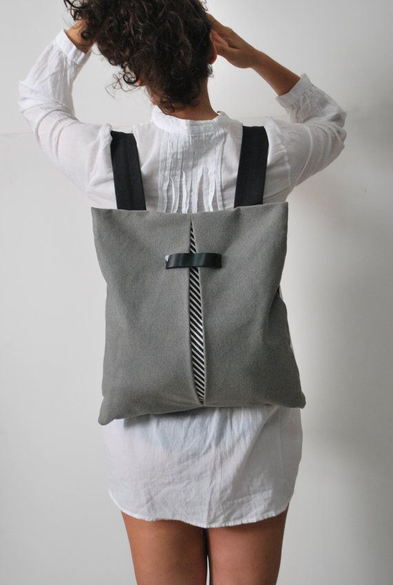 « THE SECRET b&w stripes /light gray» is a lightweight backpack / messenger bag, geometrically cut, minimally designed. As a practical, every-day bag, it can be worn either on one shoulder by letting the one strap free or as a messenger bag. Suitable and safe for documents, books, iphone, water bottle, cosmetics and more! Comfortable, functional and stylish at the same time!  >> Specifications Features: *Adjustable shoulder straps for multiple carrying options  Please send me your h...