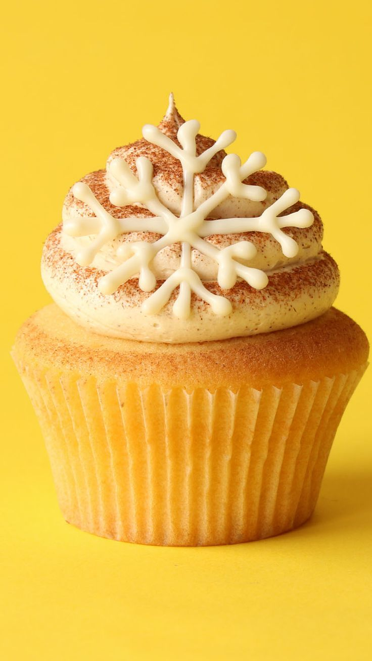 These charming vanilla eggnog cupcakes made with real eggnog. The perfect way to get into the holiday season!