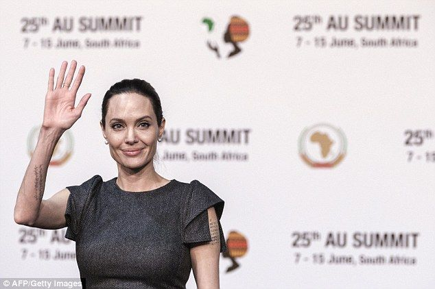 Pressing matters: It had been speculated that Jolie was heading to South Africa to celebra...
