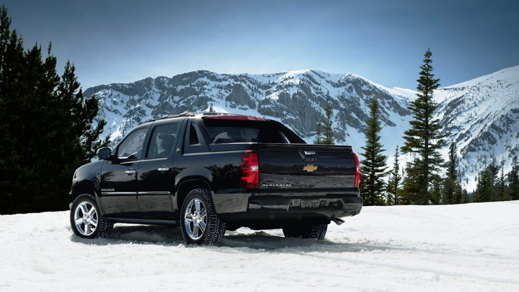 The 2013 Chevy Avalanche utility truck shown in black.