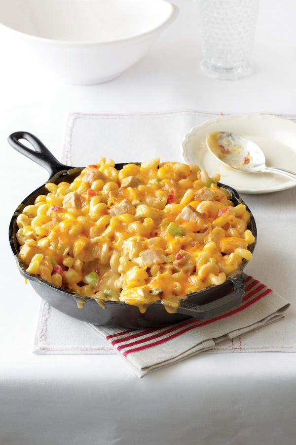 King Ranch Chicken Mac and Cheese - Cooking in Your Cast Iron Skillet - Southernliving. Recipe: King Ranch Chicken Mac and Cheese  All the flavors of a favorite casserole come together in the comfort of mac and cheese. Serve this dish to your family, and it will become a quick favorite.