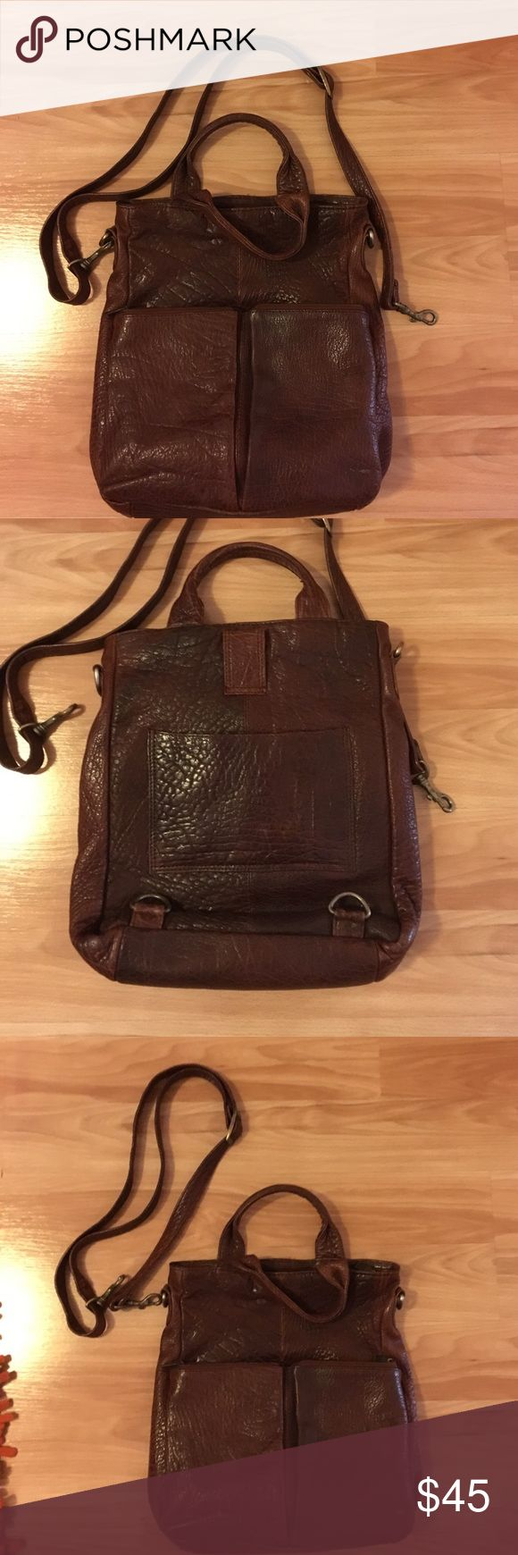 Pee-owned genuine leather Wilson convertible bag. Very unique purse that can be use 3 ways ( backpack, crossbody bag, and a small tote bag)! This is made of genuine leather and made in India. The bag has a vintage look to it. Textured dark brown leather. Bags