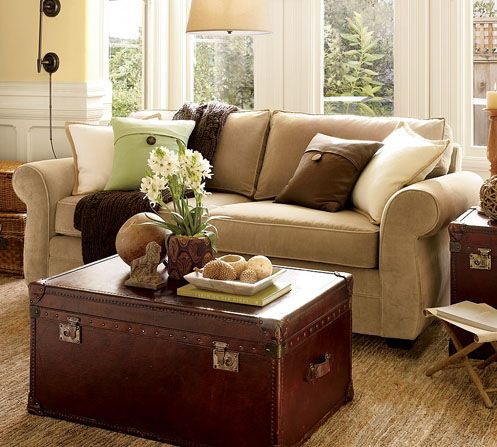 Decorating for the living room. I love the brown and green combination and the way the coffee table/trunk is decorated.