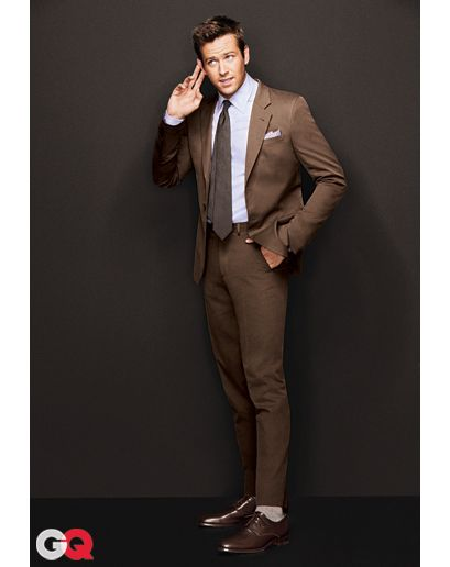 """Tobacco Brown? Who Says You Can't Smoke at Work  """"Ronald Reagan was famous for his chocolate brown suits, but the look that's back now is a lighter shade of brown—almost the color of tobacco. Put it on with a pale blue shirt and it's going to be one of the best business looks in your arsenal."""" —Lisa Cohen, GQ senior fashion editor  Image courtesy of GQ Magazine. Photography by Ben Watts"""