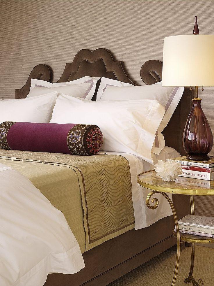 brown velvet upholstered headboard in modern symmetrical