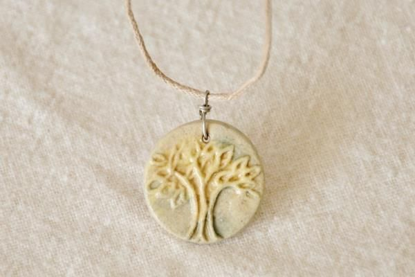 Live Love Art  Small Tree of Life Stoneware Pendant - Beige    A pretty little tree pendant in neutral tones, crafted from stoneware clay, glazed and kiln-fired.    The design was etched into a piece of plaster, making a press mold.