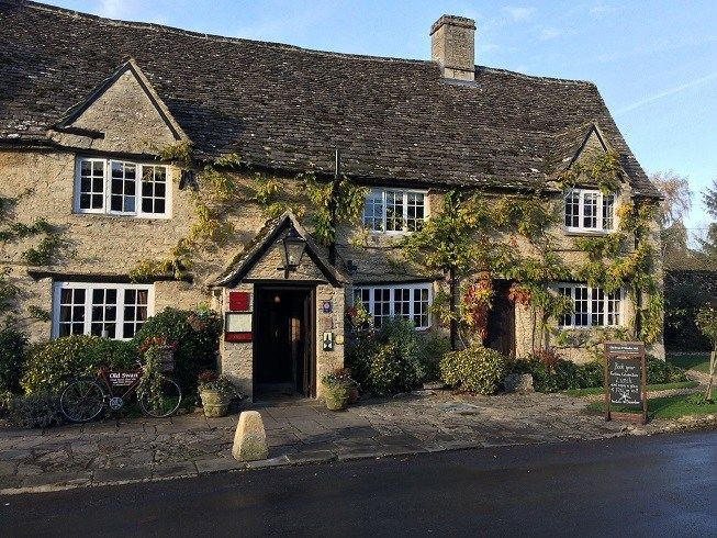 The Old Swan and Minster Mill pub with rooms in the Cotswolds village of Minster Lovell is picture perfect