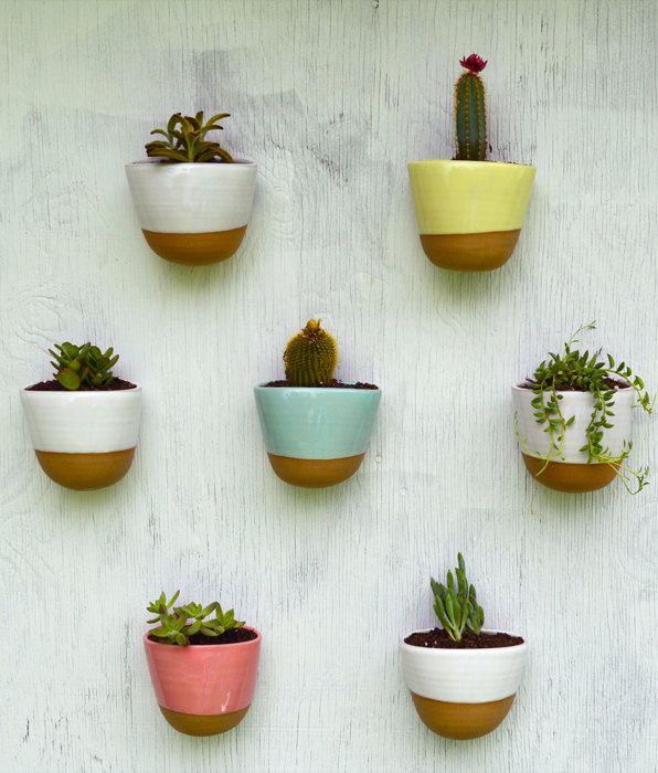stoneware wall planters by rhynoclayworks via etsy