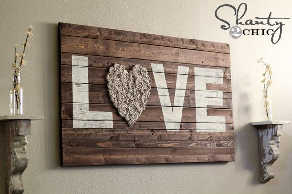 Love this DIY wood sign with rosettes from Shanty to Chic...
