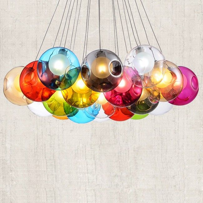 This modern minimalist pendant light features a ceiling canopy comes from chrome finish. Multi colourful glass globes are attached to the canopy via cables. Inside each globe is a glistening light. Sleek chrome finish accents and a round chrome canopy complete this dazzling contemporary look. Upgrade your home decor with this modern light fixture.