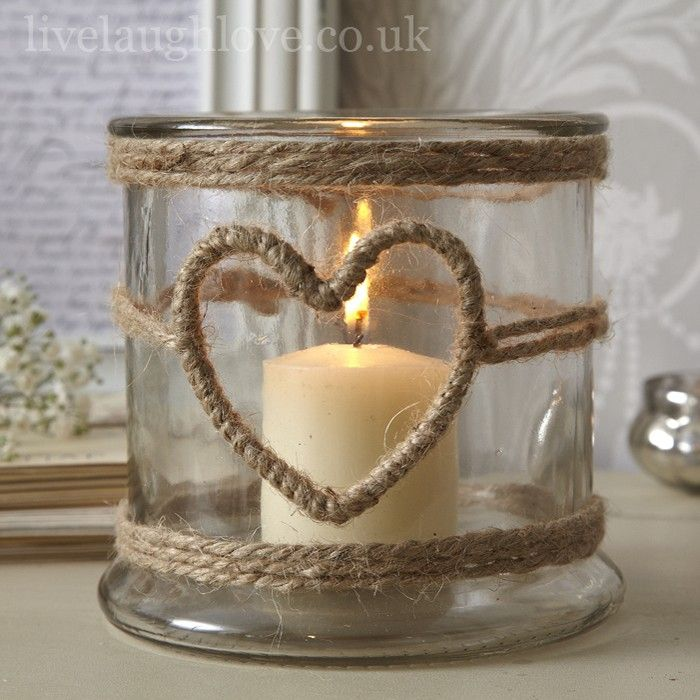 This lovely glass candle holder has a hessian string wrapped around forming layers top and bottom and a heart in the centre. This glass holder has many uses from displaying candles and tea lights to storing bits and bobs. Create a nautical theme by filling with shells or pretty stones from the sea shore. Made from sturdy glass with a simple design, this delightful heart candle holder will suit a country home to a beach retreat.