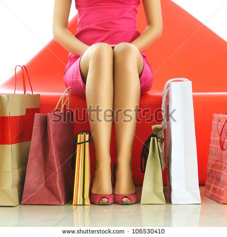 Woman with bags in shopping mall - stock photo