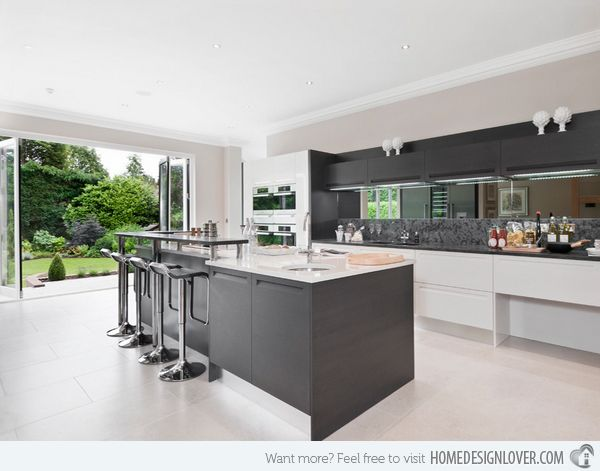 Love the grey kitchen, the mirror backsplash, fold away doors, and view.