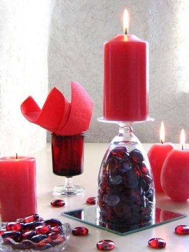 Red candles and glass