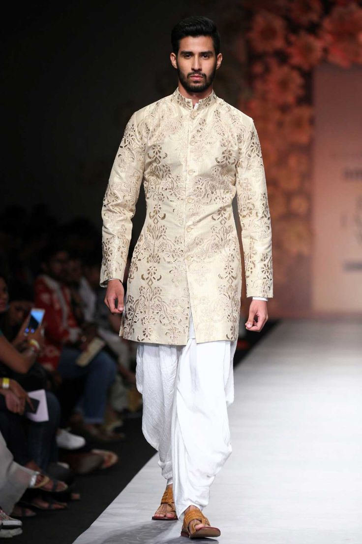 Cream and white embroideredsherwani with kurta and lungi available only at Pernia's Pop Up Shop.