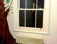 Blind in lovely child's bedroom, with painted tree