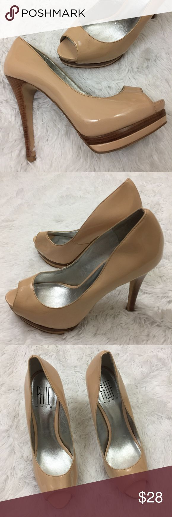 "Pella Mode nude and brown peep toe Pumps Sz 7.5 These Pelle Moda nude and brown peep toe Pumps have a 5"" heel and just under 1"" of Platform. They are in good preowned condition with no known flaws and light overall wear. The heels are a brown wood grain look and these are a great work show or party shoe!  They are a Women's size 7.5. pelle moda Shoes Heels"