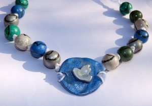 necklace with wooden beads and clay pendant, acrylic painting