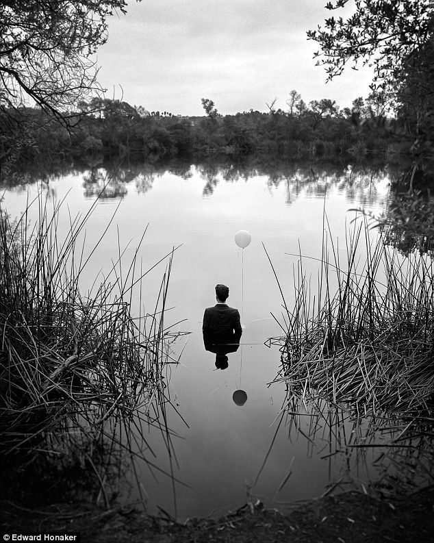 Deepest fears: The 21-year-old from California photographed himself holding a balloon while standing in waist deep water for the image titled Idling Life Cause / Feeling Suicidal