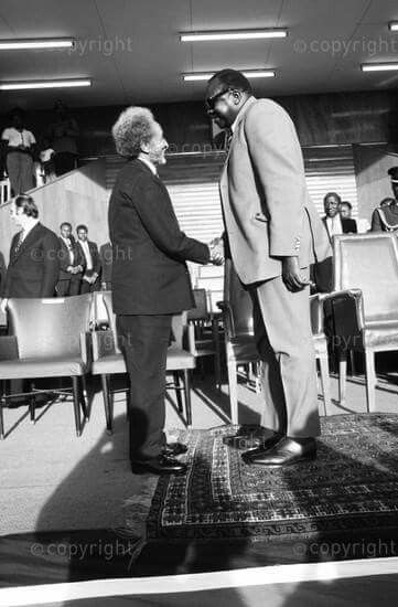 Haile Selassie I is welcomed by Ugandan president Idi Amin on his arrival in Uganda for an official state visit