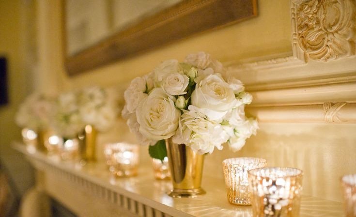 Big version of gold vase for the ceremony - move to DJ sides at the reception and add bridesmaids flowers