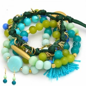 love the mix of colors (aqua, turquoise, lime) and materials (tassels, metal spacers & rings) to create a stack