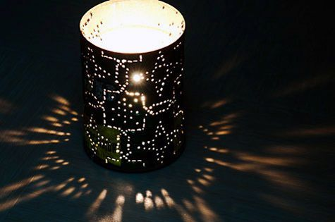 DIY coffee can lanterns!  Easy, cute and cheap!  I think I want to try this with citronella candles for our porch!