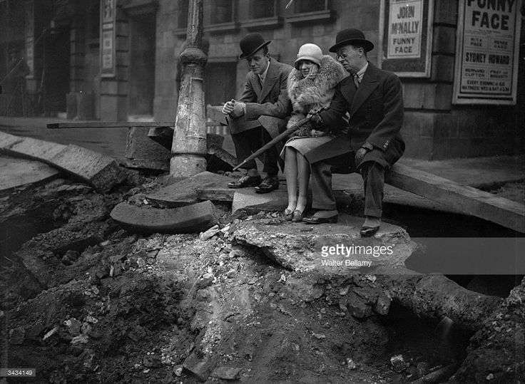 Comedian and actor Leslie Henson with Hollywood dancer, singer and film actor Fred Astaire (1899 - 1987) and his sister Adele Astaire (1898 - 1981) after an explosion at the Princes Theatre in London. 12.22.1928
