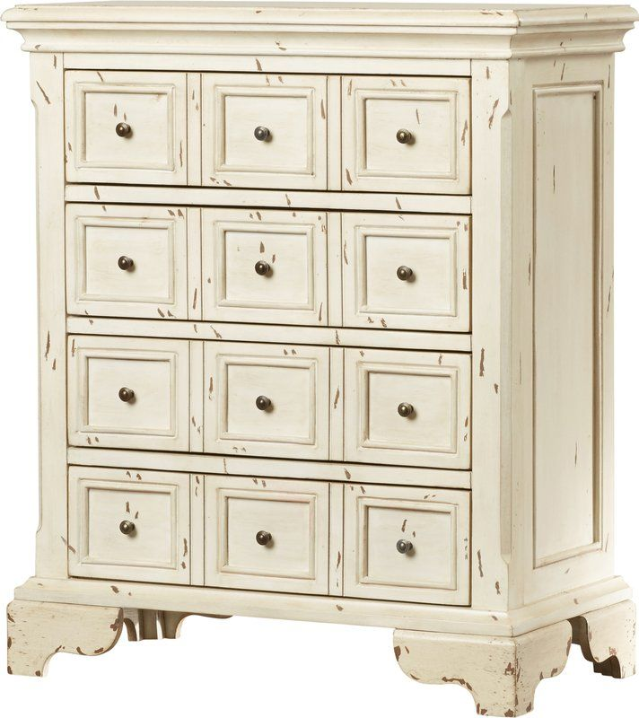 Defined by a classic apothecary-style look and weathered cream finish, this aged and eye-catching cabinet offers a touch of rustic charm to any ensemble. Set it in the living room under a faded bronze-hued wall mirror to play with its brass hardware, then top it off with a bouquet of muted faux floral blooms and a cluster of turned ceramic candleholders to round out the look. Featuring four drawers, this piece is a perfect storage solution in any space. Use the lower two drawers to keep…