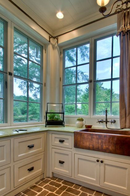 The mudroom is flanked by a laundry room and a gardening room. farmhouse laundry room by Historical Concepts Historical Concepts The gard...