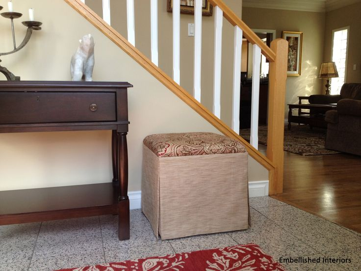 A new custom-made ottoman, table and carpet freshens up the foyer in my client's lovely home. www.embellishedinteriors.ca
