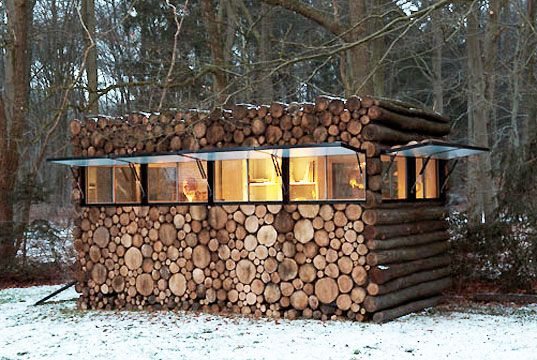Modern Log Cabin Hidden in a Stack of Wood - Commissioned by the entertainer Hans Liberg and designed by Piet Hein Eek, this music studio has a hide-and-seek exterior and bright work-all-day interior