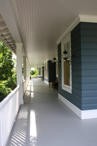 traditional porch by Rugo/ Raff Ltd. Architects, blue siding, white trim, grey floor via houzz