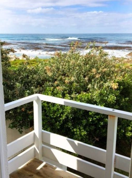 House in Betty's Bay, South Africa. Comfortable family beach house overlooking the sea.  Step out of the garden and the sea is in front of you.  Braai while you watch the waves rolling. Turn left and the beach is 2 minutes walk.  Situated at the end of a quiet road, so no traffic to...
