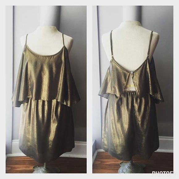Elizabeth and James Brenna Dress Gold metallic silk charmeuse Elizabeth and James dress perfect for your next cocktail party! Arched top layer hits around waist level, and skirt falls about mid-thigh. I've only worn this dress 3 times, so it's still in good condition. Will add more photos later! Elizabeth and James Dresses Mini