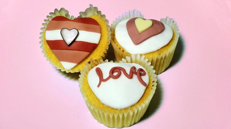 Valentine's heart shaped cupcakes. Surprise your loved one with the gift of a beautiful heart shaped cake. This video gives instructions for how to shape a c...