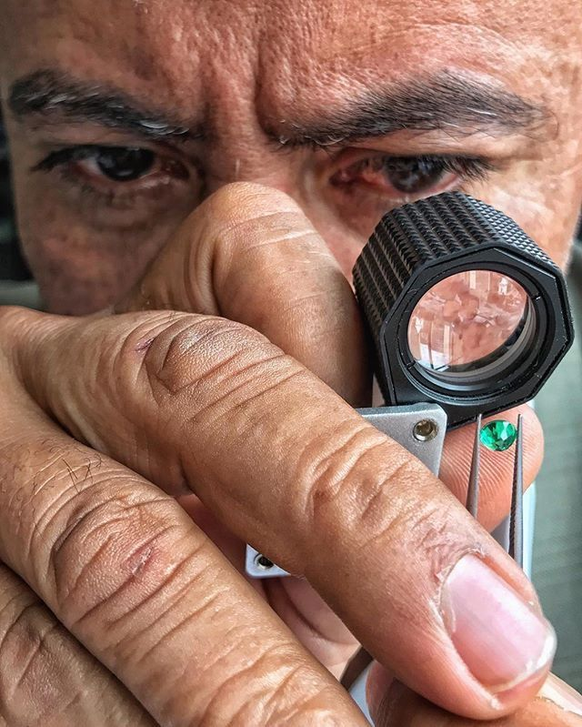 IEEX Emeralds - A close up of one of the Bogota team inspecting a emerald , Fabio Valencia takes care of all our emerald treatment, with  35 years plus experience.