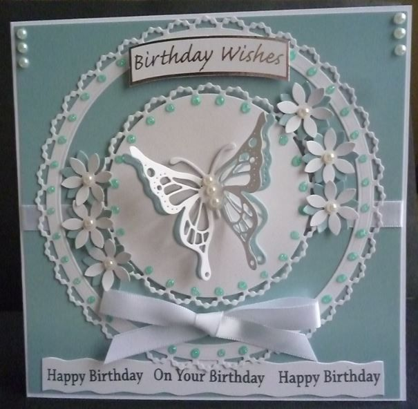 Card made using the Pearl Doily die of tattered lace and the tonic butterfly die