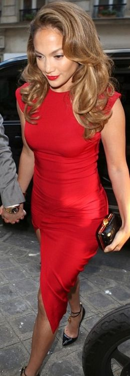 Jennifer Lopez in a red Hakaan dress and Tom Ford shoes.