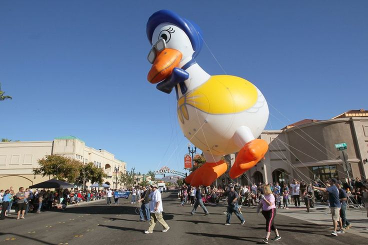 The big helium filled Mother Goose makes her way down W. Main Street. Mother Goose Parade 2014