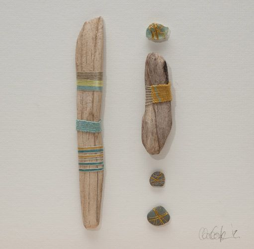 Beachcombed driftwood, approx 23cm x 23cm (box framed) Beach-combed driftwood and sea glass, cotton, silk, metallic thread, cotton warp by Clare Coyle