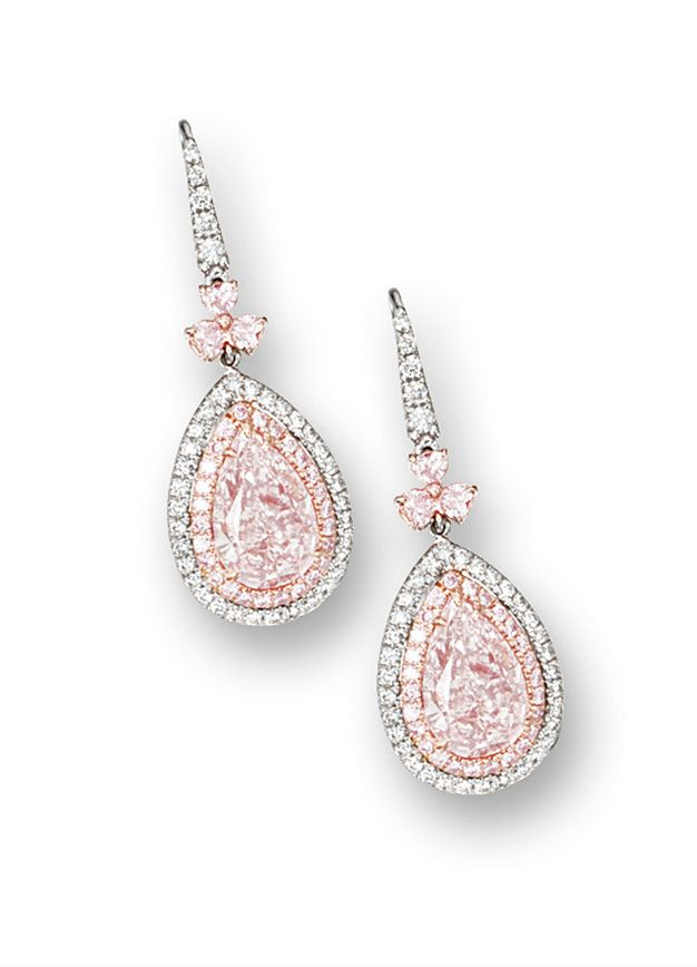 PAIR OF FANCY LIGHT PINK DIAMOND, PINK DIAMOND AND DIAMOND PENDENT EARRINGS.  Each suspending on a pear-shaped fancy light pink diamond weighing 2.74 and 2.96 carats respectively, surrounded by brilliant-cut pink diamonds, to an outer surround set with brilliant-cut diamonds, surmounted by three heart-shaped pink diamonds, completed by a brilliant-cut diamond-set hook, the pink diamonds and diamonds altogether weighing approximately 1.35 carats, mounted in 18 karat pink and white gold.