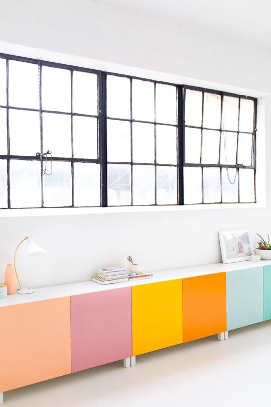 To get this playful look, pick out a few different bright spray paints for the doors of your IKEA cabinets and go to town.