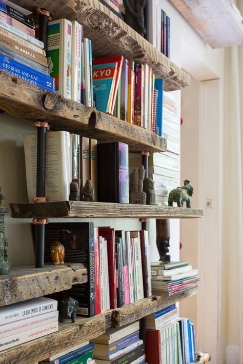 Pipe and Wood Shelving from: John & Fabien's Elemental Home — House Tour | Apartment Therapy