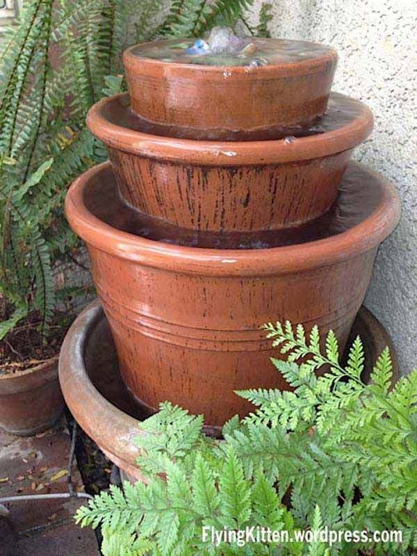 Make A Clay Pot Fountain: 26 Budget-Friendly and Fun Garden Projects Made with Clay Pots
